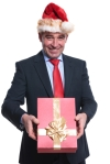 happy mature business man with santa hat  is giving you a presen