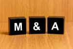 M&A or Merger and Acquisition text on block